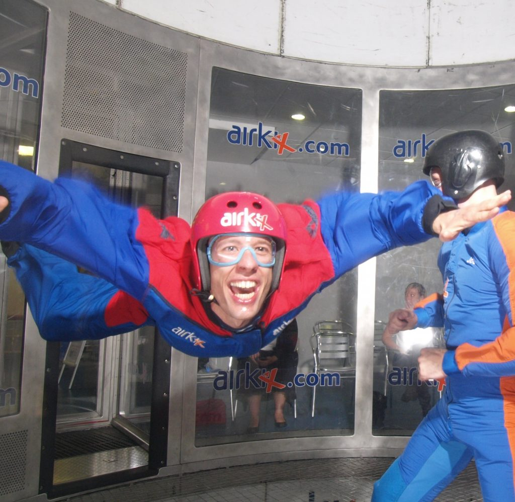 Michael, during indoor skydiving, with a huge grin on his face